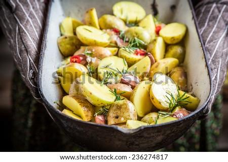 Enjoy your roasted potatoes with rosemary - stock photo