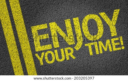 Enjoy your Time! written on the road - stock photo