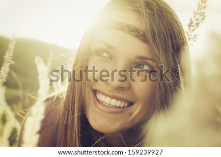 Enjoying autumn / Vintage style photo from a beautiful woman in autumn - stock photo