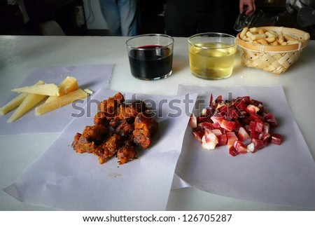 Enjoying some cheese and jam tapas in a typical bar in Cadiz, Andalusia, Spain. - stock photo