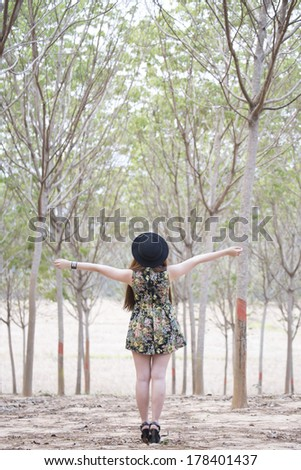 Enjoying the nature. Young woman arms raised enjoying   in autumn    - stock photo
