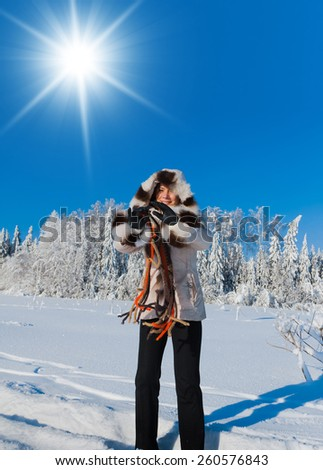 Enjoying the Snow Midwinter Sunshine  - stock photo