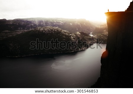 Enjoying the view from The Pulpit Rock in Norway - stock photo
