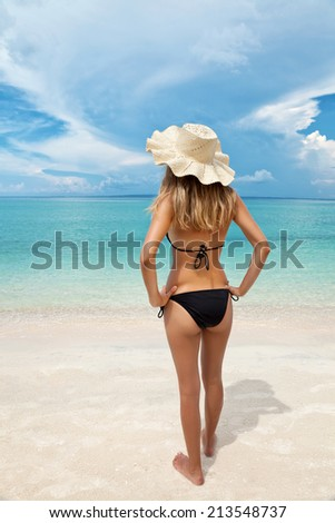 Enjoying the white sand and turquoise waters on a holiday - stock photo