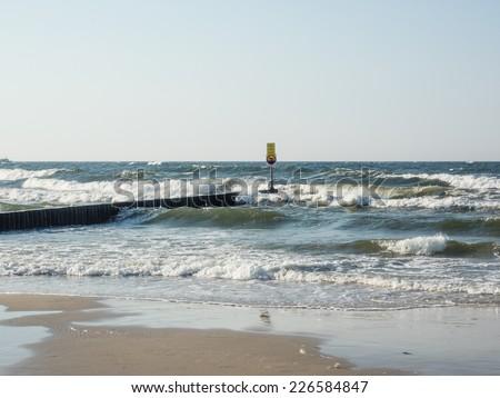 Enjoying warm summer day on the beach in Kolobrzeg. - stock photo