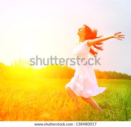 Enjoyment. Free Happy Woman Enjoying Nature. Beauty Girl Outdoor. Freedom concept. Beauty Girl over Sun - stock photo