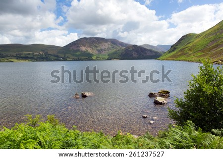 Ennerdale Water Lake District National Park Cumbria England uk surrounded by fells including Great Gable, Green Gable, Brandreth, High Crag, Steeple and Pillar  - stock photo