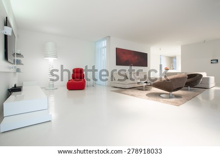 Enormous elegant lounge with white marble floor - stock photo