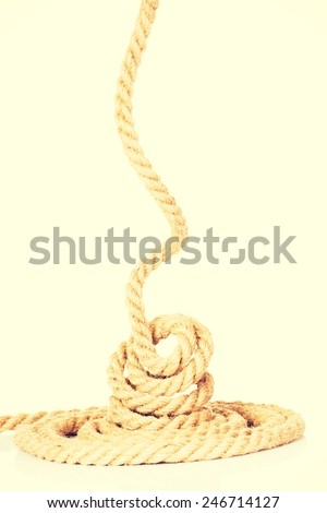 Enrolled long thick brown rope. - stock photo
