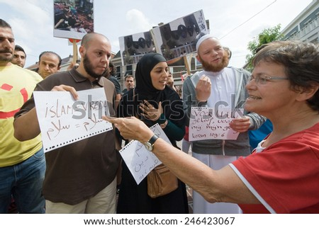 ENSCHEDE, NETHERLANDS - AUG 03, 2014: During a demonstration organized by suryoye christians against the slaughter of christians in the middle east there is a discussion by pro and contra muslims - stock photo