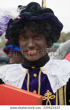 ENSCHEDE, THE NETHERLANDS - NOV 14, 2015: Black Pete is the helping hand of the dutch Sinterklaas - stock photo