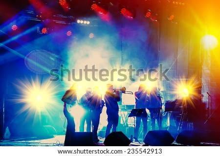 ensemble playing night concert on the stage - stock photo