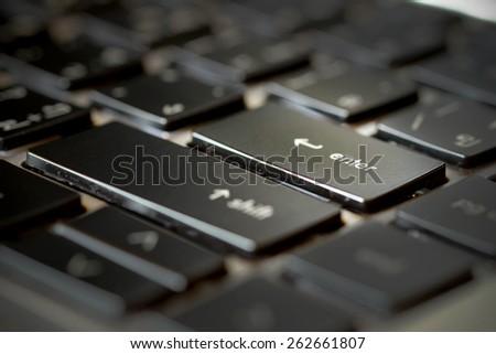 Enter button on laptop keyboard - stock photo
