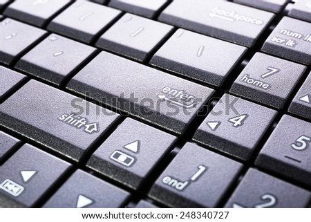 Enter button on the computer keyboard - stock photo