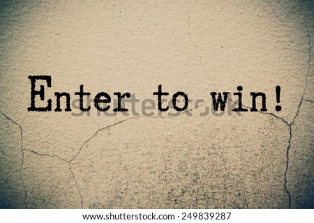 Enter to win concept on wall  - stock photo