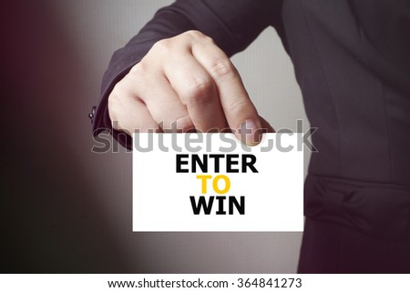 ENTER TO WIN paper on the card , business concept , business idea - stock photo