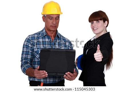Enthusiastic engineer working with an engineer - stock photo