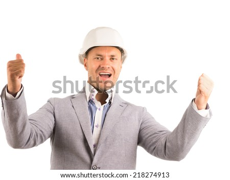 Enthusiastic male engineer or manager wearing white hardhat while showing thumbs up or pointing upwards portrait on white - stock photo