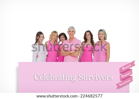 Enthusiastic pretty women posing for breast cancer against pink card - stock photo