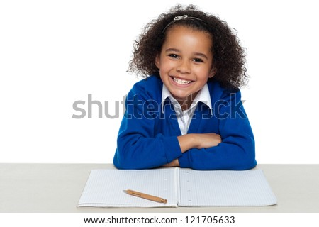 Enthusiastic student paying attention in the class isolated on white background. - stock photo