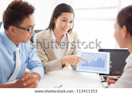 Enthusiastic team presenting the results of the work to the leader - stock photo