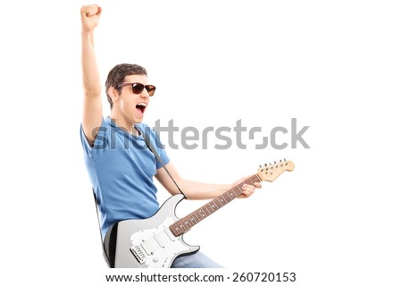Enthusiastic young guitarist playing electric guitar isolated on white background - stock photo