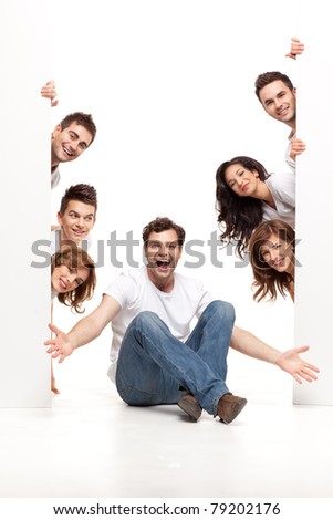 enthusiastic young man sitting with happy friends - stock photo