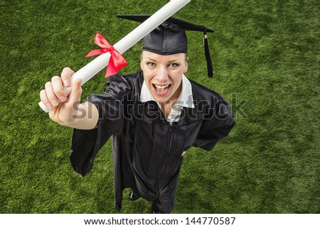 Enthusiastic Young Woman with College Degree - stock photo