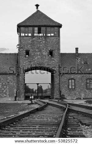 Entrance at Auschwitz / Birkenau and train tracks - stock photo