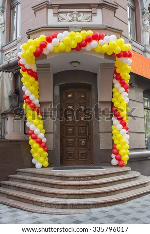 Entrance decorated with colorful balloons - stock photo