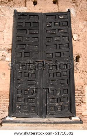 Entrance door in the El Badi Palace in Marrakech, Morocco - stock photo