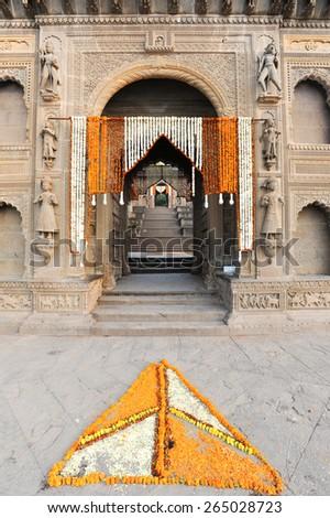 Entrance door of temple palace at Maheshwar on India - stock photo