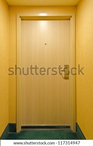 Entrance door to hotel room - stock photo