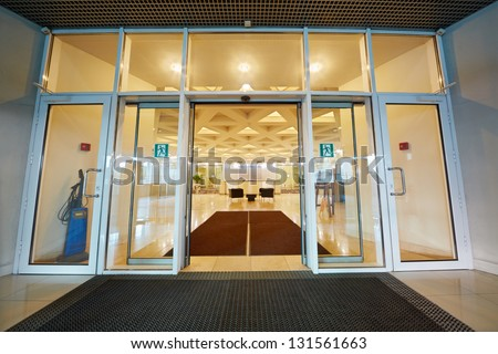 Entrance door to reception hall of office building - stock photo
