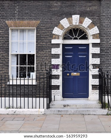 Entrance facade to 18th century Georgian London townhouse. - stock photo