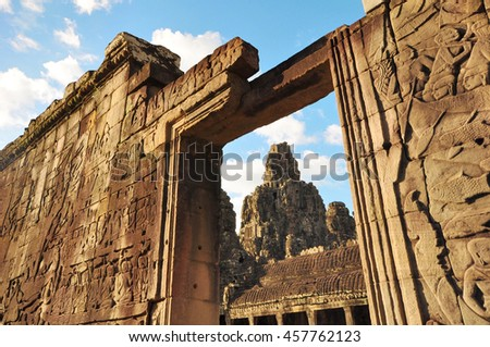 Entrance framing a tower in ancient Bayon Temple in Angkor Thom city, Siem Reap in Cambodia - stock photo