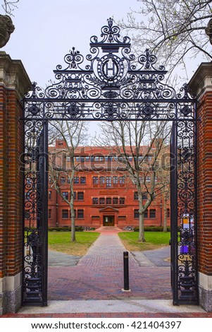 Entrance gate and East facade of Sever Hall in Harvard Yard in Harvard University of Cambridge, Massachusetts, MA, USA. It is used as the library, lecture hall and classroom for different courses. - stock photo