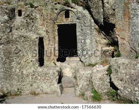entrance in cave church,Geghard,armenia - stock photo