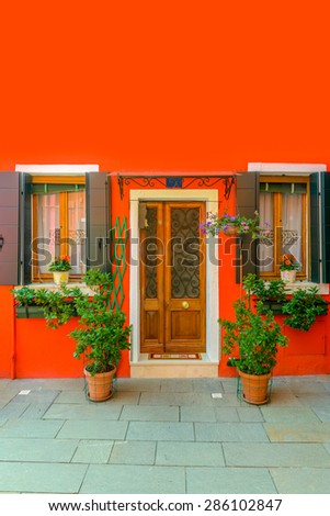 Entrance of a colorful apartment building in Burano, Venice, Italy. - stock photo