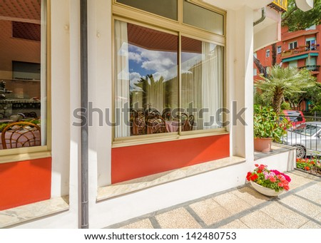 Entrance of a hotel with view to dining room. - stock photo