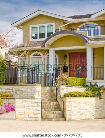 Entrance of a house with gorgeous outdoor landscape - stock photo
