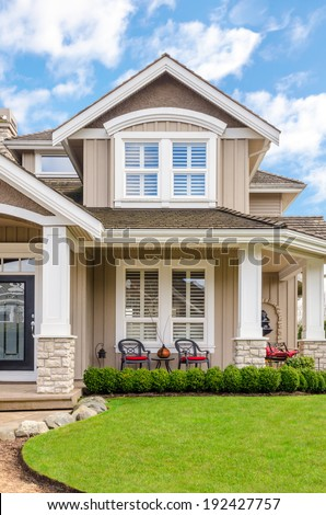 Entrance of a luxury house with a patio on a bright, sunny day in Vancouver, Canada. - stock photo