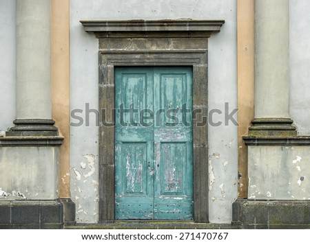 Entrance of an old church - stock photo