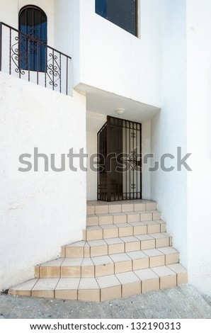 Entrance of apartment building in Puerto Vallarta, Mexico. - stock photo