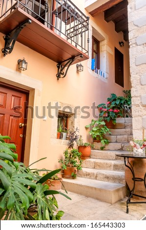 Entrance of courtyard of old mediterranean town - stock photo