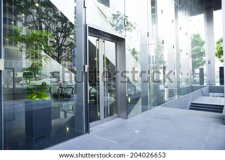 Entrance of the stylish office building - stock photo