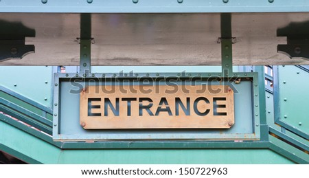 entrance sign on wall  - stock photo