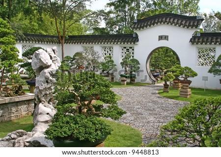 Entrance to a bonsai garden in a chinese temple - stock photo