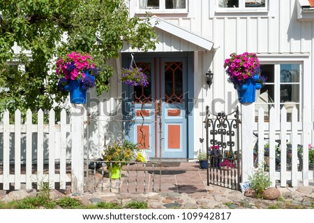 Entrance to an old house in Pataholm, a very small town at the east coast of Sweden - stock photo