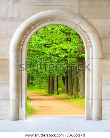 Entrance to green oak alley - conceptual image - environmental business metaphor. - stock photo